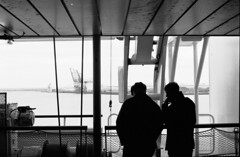 The passengers (Elios.k) Tags: horizontal outdoors people two men passengers deck boat ferry atsea backlit silhouette shadow light port ferryterminal dof depthoffield focusonforeground backgroundblur bokeh crane industrial loadingdock sea water blackandwhite bw mono monochrome travel travelling march 2018 vacation canon camera photography englishchannel dunkirk dunkerque france europe indoors interior window round nopeople circular symmetry geometry table café cafeteria bowl waste trash dirty reflection minimal canon5dmkii dover uk england unitedkingdom film analoguephotography scannedfilm agfaapx100 analogfilm grain contrast canona1 a1 analogcamera
