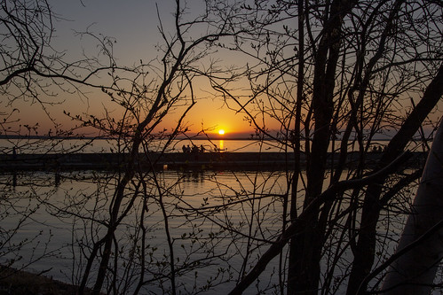 Sunset and people on the breakwater, Waskesiu, Prince Albert National Park, Saskatchewan