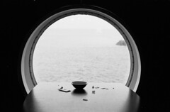 Imperfection (Elios.k) Tags: horizontal indoors interior boat ferry window round nopeople atsea circular symmetry geometry table café cafeteria dof depthoffield backlit shadow light bowl waste trash dirty reflection minimal blackandwhite bw mono monochrome travel travelling march 2018 vacation canon camera photography englishchannel dover uk dunkirk dunkerque france england unitedkingdom europe canon5dmkii film analoguephotography scannedfilm agfaapx100 analogfilm grain contrast canona1 a1 analogcamera
