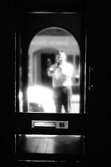 86 (Henry Hemming) Tags: bw house housenumber door doornumber mirror reflection passerby selfie sonyrx100 unclear