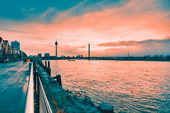 Duesseldorf, GERMANY - February 09, 2019: Vivid sunlight breaks through grey winter sky and iluminates the Rhine promenade (axel-d-fischer) Tags: bridge cloudy water city riverside alongtheriver sun smalltown shorepromenade oldtown rhein boat rhine edge dsseldorf rheinturm eveningsun waterfront sunset european germany buildings cityscape evening town skyline blue ship residentialbuildings duesseldorf travel building communication promenade architecture sunlight architectural europe dusseldorf facade