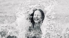 Klara in den Wellen - fun into the waves (MLe Dortmund) Tags: klara tochter wellen spash schwarzweis noordhollandholland callantsoog nordsee northsea monochrome blackandwhite waves schwarzweiss fun spas meer sea
