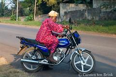 A helmet might be better? (10b travelling / Carsten ten Brink) Tags: africa man african places motorbike riding westafrica nigeria motorcycle afrika afrique nigerian 2018 africaine idanre cmtb otherkeywords tenbrink carstentenbrink iptcbasic 10btravelling abeokuta western westernregion
