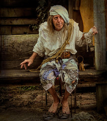 Pirate begger (Millie Cruz) Tags: pirate begger pennsylvaniarenaissancefaire pennsylvania textures topazstudio man people gritty tamron18400mmf3563diiivchld canoneosrebelt6i painting photopainting