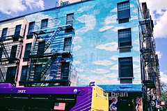 Blend In, Stand Out (boodoo) Tags: street manhattan eastvillage x100 rawtherapee fujifp100c blue sky mural purple yellow bean haldclut