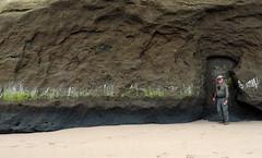 Unusual (LeftCoastKenny) Tags: pomponiostatebeach beach sand hiker cliff green white markings recess