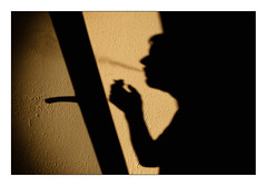 smoker (Armin Fuchs) Tags: arminfuchs thomaslistl light shadows cigarette smoking diagonal window smoke niftyfifty