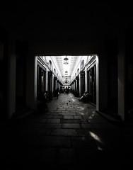 The Covent Garden Hallway (Steve Taylor (Photography)) Tags: architecture column lamp light pavement monochrome blackandwhite stone people uk gb england greatbritain unitedkingdom perspective coventgarden london