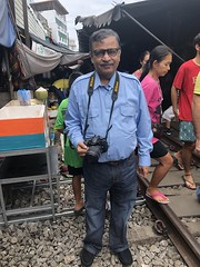I still couldn't believe a train had passed by just moments earlier (shankar s.) Tags: seasia thailand bangkok krungthepmahanakhon krungthep bangkoksuburbs outskirtsofbangkok maeklongrailway localmarket localcommerce riversideshopping touristattraction runningrightthroughthemarket dangerouslyclose localproduce fruitandvegetablemarket wetmarket maeklong maeklongtrainmarket maeklongrailwaymarket talatromhup umbrellapulldownmarket exotic safetyhazard railwaystation trainstation srt staterailwaysofthailand dieselrailcartrain dieselmultipleunit dmu