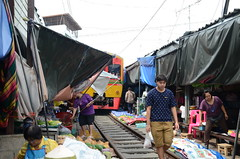 The awnings come back down seconds after the train has passed (shankar s.) Tags: seasia thailand bangkok krungthepmahanakhon krungthep bangkoksuburbs outskirtsofbangkok maeklongrailway localmarket localcommerce riversideshopping touristattraction runningrightthroughthemarket dangerouslyclose localproduce fruitandvegetablemarket wetmarket maeklong maeklongtrainmarket maeklongrailwaymarket talatromhup umbrellapulldownmarket exotic safetyhazard railwaystation trainstation srt staterailwaysofthailand dieselrailcartrain dieselmultipleunit dmu