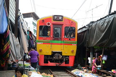Having just passed me, the incoming train moves towards the station (shankar s.) Tags: seasia thailand bangkok krungthepmahanakhon krungthep bangkoksuburbs outskirtsofbangkok maeklongrailway localmarket localcommerce riversideshopping touristattraction runningrightthroughthemarket dangerouslyclose localproduce fruitandvegetablemarket wetmarket maeklong maeklongtrainmarket maeklongrailwaymarket talatromhup umbrellapulldownmarket exotic safetyhazard railwaystation trainstation srt staterailwaysofthailand dieselrailcartrain dieselmultipleunit dmu