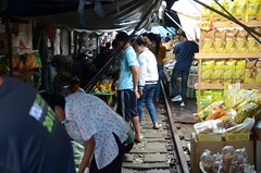 See the train tracks running right through the busy market? (shankar s.) Tags: seasia thailand bangkok krungthepmahanakhon krungthep bangkoksuburbs outskirtsofbangkok maeklongrailway localmarket localcommerce riversideshopping touristattraction runningrightthroughthemarket dangerouslyclose localproduce fruitandvegetablemarket wetmarket maeklong maeklongtrainmarket maeklongrailwaymarket talatromhup umbrellapulldownmarket exotic safetyhazard railwaystation trainstation srt staterailwaysofthailand dieselrailcartrain dieselmultipleunit dmu