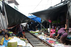 Back to business as usual- can you believe there was a train there just moments earlier? (shankar s.) Tags: seasia thailand bangkok krungthepmahanakhon krungthep bangkoksuburbs outskirtsofbangkok maeklongrailway localmarket localcommerce riversideshopping touristattraction runningrightthroughthemarket dangerouslyclose localproduce fruitandvegetablemarket wetmarket maeklong maeklongtrainmarket maeklongrailwaymarket talatromhup umbrellapulldownmarket exotic safetyhazard railwaystation trainstation srt staterailwaysofthailand dieselrailcartrain dieselmultipleunit dmu