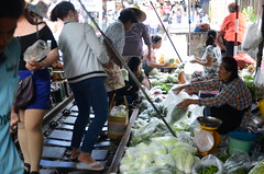 Apparently the market was there long before the trains (shankar s.) Tags: seasia thailand bangkok krungthepmahanakhon krungthep bangkoksuburbs outskirtsofbangkok maeklongrailway localmarket localcommerce riversideshopping touristattraction runningrightthroughthemarket dangerouslyclose localproduce fruitandvegetablemarket wetmarket maeklong maeklongtrainmarket maeklongrailwaymarket talatromhup umbrellapulldownmarket exotic safetyhazard railwaystation trainstation srt staterailwaysofthailand dieselrailcartrain dieselmultipleunit dmu