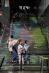 Shibuya kimono trio in the rain. (sapphire_rouge) Tags: tokyo shibuya rain 東京 渋谷 kimono lady illumination 着物 雨 girl shibuyastream 渋谷ストリーム 渋谷川