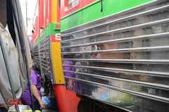 So close- had I put my tongue out, I could have licked the sides of the train! (shankar s.) Tags: seasia thailand bangkok krungthepmahanakhon krungthep bangkoksuburbs outskirtsofbangkok maeklongrailway localmarket localcommerce riversideshopping touristattraction runningrightthroughthemarket dangerouslyclose localproduce fruitandvegetablemarket wetmarket maeklong maeklongtrainmarket maeklongrailwaymarket talatromhup umbrellapulldownmarket exotic safetyhazard railwaystation trainstation srt staterailwaysofthailand dieselrailcartrain dieselmultipleunit dmu