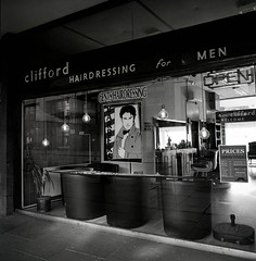 Clifford. Hairdressing for men- since 1969 (suzannesullivan2) Tags: ilford ilfosol bronica delta100 bw shop hairdresser barbers