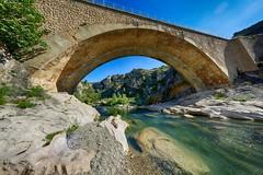 Bridge over la Berre (Bendigoish) Tags: hdr bridge fisheye wide angle stone sun light backlit river limestone