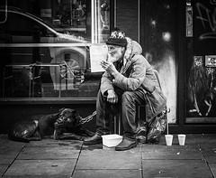 IMG_1000000 (Kathi Huidobro) Tags: streetphotography london eastlondon citylife urban blackwhite bw monochrome neverjudge streetlife portrait pensive streetportrait candid mananddog londoners londonstreets