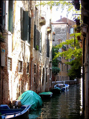 Canal in Venice. (Country Girl 76) Tags: venice italy small canal back street buildings architecture trees scene boats windows water reflections balcony