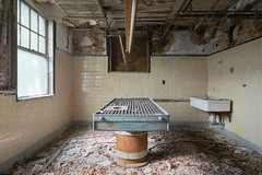 ...no one gets out alive... (Art in Entropy) Tags: abandoned hospital morgue table creepy grime urban explore exploration decay derelict lost decrepit rust asylum adventure photography art entropy sony sonyalpha light