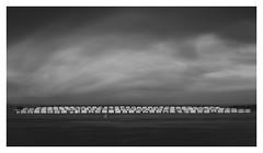 Stacked (Marco Maljaars) Tags: longexposure northsea dutch le blackandwhite marcomaljaars velsen monochrome minimalism sky mood light bw netherlands cabinet ijmuiden house beach cabinets clouds impressive stormy stack stacked