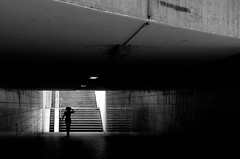 WIR SIND STREUNER (helmet13) Tags: street people urban bw woman silhouette backlight subway leicaxvario aoi peaceaward world100f