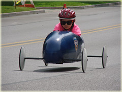 Little Soapbox Derby Racer with Big Sunglasses ... (Davey Z(3)) Tags: little racer with big sunglasses car wheels girl helmet intense look hill street competition young racers colors kids race tires indiana girls build wood drive downhill davey z 1 2 3 soapbox derby valparaiso