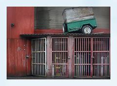 Trailer On a Hot Thin Roof (Robert Drozda) Tags: portland oregon trailer stilllife roof cage tank gascylinder lock corrugated drozda