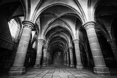 """Salle des Chevaliers (Knight's Hall), Mont Saint Michel, Manche, Normandie, France. fine art, black & white (grumpybaldprof) Tags: """"montstmichel"""" """"stmichael'smount"""" avranches manche normandy france tidal island sea abbey """"bayeuxtapestry"""" monastery """"8thcentury"""" unesco """"worldheritagesite"""" fortifications """"quicksand"""" castle """"salledeschevaliers"""" """"knight'shall"""" columns windows light contrast bw blackwhite """"blackwhite"""" """"blackandwhite"""" noireetblanc monochrome """"fineart"""" ethereal striking artistic interpretation impressionist stylistic style shadow dark black white illuminated mood moody atmosphere atmospheric calm peaceful tranquil restful interior inside building architectures indoors canon 70d """"canon70d"""" sigma 1020 1020mm f456 """"sigma1020mmf456dchsm"""" """"wideangle"""" ultrawide lightrays"""