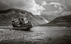 Caol (Rodney Harvey) Tags: infrared scotland abandoned boat ship loch storm rain mountains beached decay shipwreck weather clouds black white marooned ben nevis scottish highlands