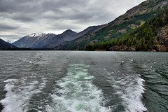 Wake Waters and a Goodbye to the Lake Chelan National Recreation Area (North Cascades National Park Service Complex) (thor_mark ) Tags: azimuth323 boatride boatridetochelan boatwake bonanzamassif capturenx2edited cascaderange centralnorthcascades cloudy colorefexpro day6 ferryride frombackofboat frombackofship hillsideoftrees ladyofthelake lake lakechelan lakechelannationalrecreationarea landscape lookingnw mcgregormountain methowmountains mountainpeak mountains mountainsindistance mountainsoffindistance mountainside nature nikond800e northcascades northcascadesnationalparkcomplex northcascadesnationalparkservicecomplex northmethowmountains outside overcast pacificranges project365 purplemountain rainbowmountain ridge sawtoothridge shipwake snowonfaroffmountainpeaks snowcapped trees triptonorthcascadesandwashington tupshinpeak wake lakechelannationalrecreation washington unitedstates