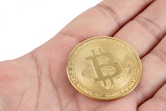 Golden Bitcoin in the hand (wuestenigel) Tags: crypto bit cryptography background bitcoin banking coin symbol money golden trade isolated business btc web electronic market payment financial concept currency hold gold economy hand bank finance man internet mining metal digital virtual white object network sign exchange pay cash
