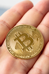 Metal Bitcoin in the hand (wuestenigel) Tags: crypto bit cryptography background bitcoin banking coin symbol money golden trade isolated business btc web electronic market payment financial concept currency hold gold economy hand bank finance man internet mining metal digital virtual white object network sign exchange pay cash