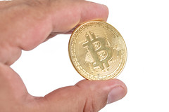 Golden Bitcoin in the hand above white background (wuestenigel) Tags: crypto bit cryptography background bitcoin banking coin symbol money golden trade isolated business btc web electronic market payment financial concept currency hold gold economy hand bank finance man internet mining metal digital virtual white object network sign exchange pay cash