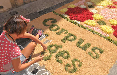Working on a floral street carpet, Sitges