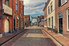 Take Him To The Bridge (Alfred Grupstra) Tags: architecture street urbanscene city buildingexterior europe history builtstructure town old famousplace outdoors travel house netherlands cityscape cultures tourism citylife bicycle 979 oudewater