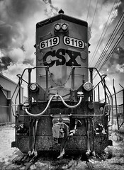 CSX 6119 (Burnt Umber) Tags: rpilla001 phoneography fauxtography silverefex black white weiss negra negro machine magnet demolition train yard recovery hydrolic industrial clous sky florida fort lauderdale bad ass ©allrightsreserved flurbex urbex blanco noir schwarz weis boxcar railcar rail trump graffiti tag tagged csx locomotive diesel electric gp402