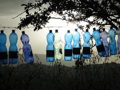 singing bottles (nightcloud1) Tags: blu percussion veggiegarden plasticbottles transparency sunset sibillinimountains wind rattling sculpture mobile