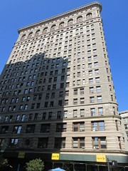 Flatiron Building Eastern Side View NYC 2562 (Brechtbug) Tags: 2019 flatiron building across from madison square park next broadway 23rd street 5th avenue nyc 2018 rooftop roof top architecture statuary gargoyle figure myth mythological mythology wheat shield worker workers artwork above skyline citytop cityscape view new york city june 06232019 tower wedge towering