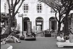 Relaxed on outdoor cushion (Thanathip Moolvong) Tags: olympus om1 rollei rpx 100 bw film people life