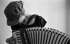Breathing Bellows (Mano Green) Tags: accordion woman playing musical instrument music person hat keys buttons bellows scarborough north yorkshire england uk summer september 2016 canon eos 300 40mm lens ilford hp5 400 35mm film black white ilfosol s epson perfection v550 portrait shadow light