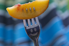 Happy Summer! (brucetopher) Tags: macromondays stylingfoodonafork styling food fork macro peach yellow orange happy smile sweet umbrella summer stonefruit fruit peaches happyface face smiling metal tines grin wave waves succulent moist refreshing refresh delicious local farmfresh fresh