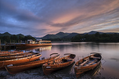 Derwent Water (littlenorty) Tags: type landscape colour bodiesofwater lake derwentwater geography europe unitedkingdom england cumbria lakedistrict keswick objects boats rowing buildings leisurebuildings pier nature sun sunset goldenlight goldenhour reflection