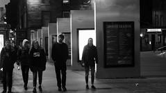 Nocturnal Stroll 01 (byronv2) Tags: edinburgh edimbourg scotland street lothianroad blackandwhite candid peoplewatching walking sign signs night nuit nacht edinburghbynight