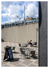 Open Cafe (Dave Button) Tags: cafe sun blue sky terrace fuji fujifilm color colour provia clouds tram nottingham outdoor border xf23mmf2 space seats tables coffee city urban street
