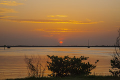 It's going to be another scorcher (mimsjodi) Tags: sunrise sky water indianriverlagoon grass boats sailboat clouds titusvillefl