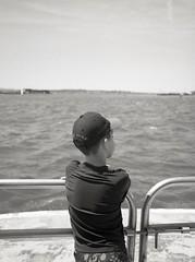 the boy in the boat (triebensee) Tags: bronica rf645 zenzanon 65mm f4 ilfordhp5plus kodakhc110 dilutionh epsonv700 film selfdeveloped mediumformat 6x45 governorsisland porchstomp2019
