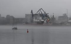 Industrial island (AstridWestvang) Tags: boat buoy crane factory fog harbour industry porsgrunn telemark