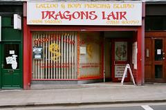 Dragons Lair (Peter.Bartlett) Tags: minoltax700 shopfront portra400 facade doorway film colour kirklees doubleyellowlines urban uk westyorkshire unitedkingdom shopwindow peterbartlett huddersfield sign door kodak england